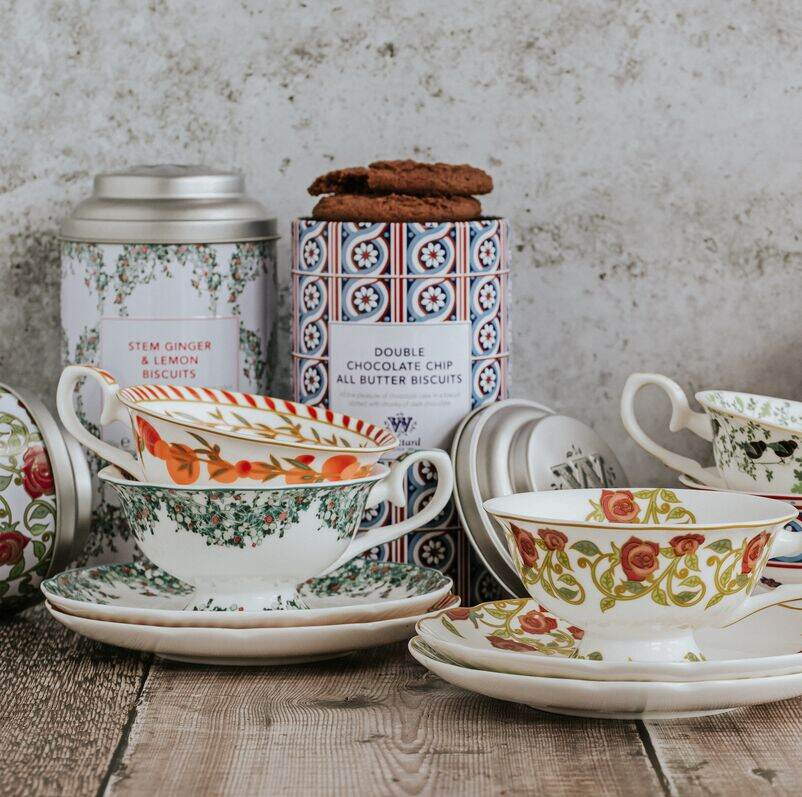 Range of Tea Cups and Saucers with Tea Discoveries Biscuits