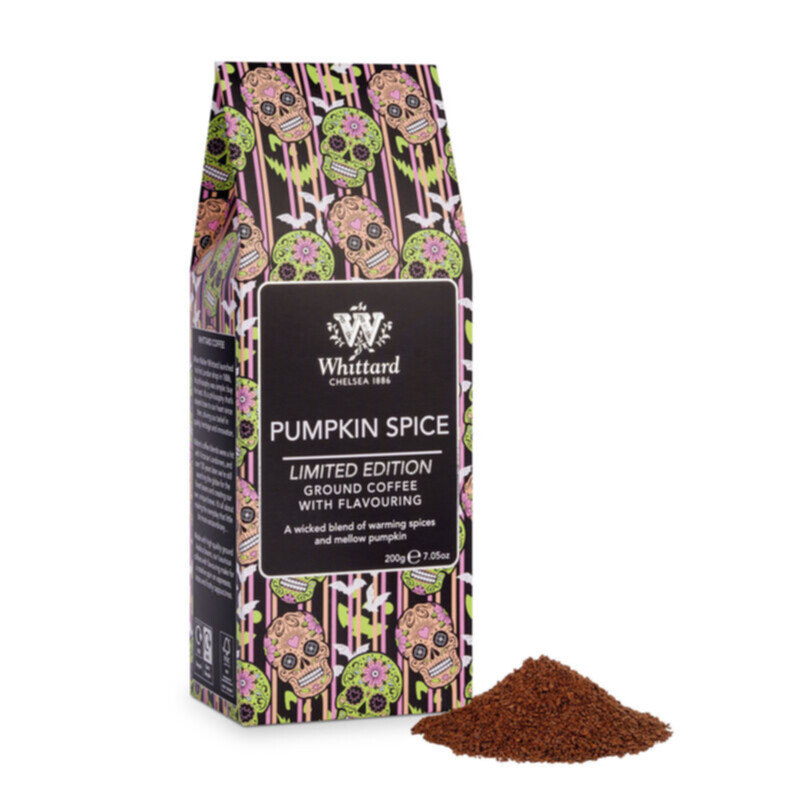 Limited Edition Pumpkin Spiced Coffee with ground coffee out of packet