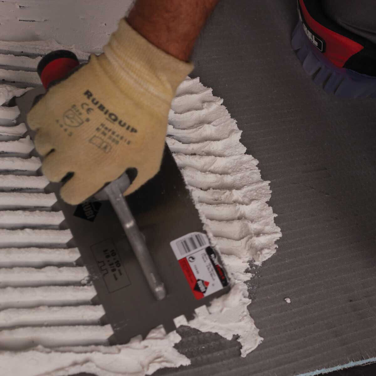 Spreading Thinset on Tile Backerboard with Rubi Trowel