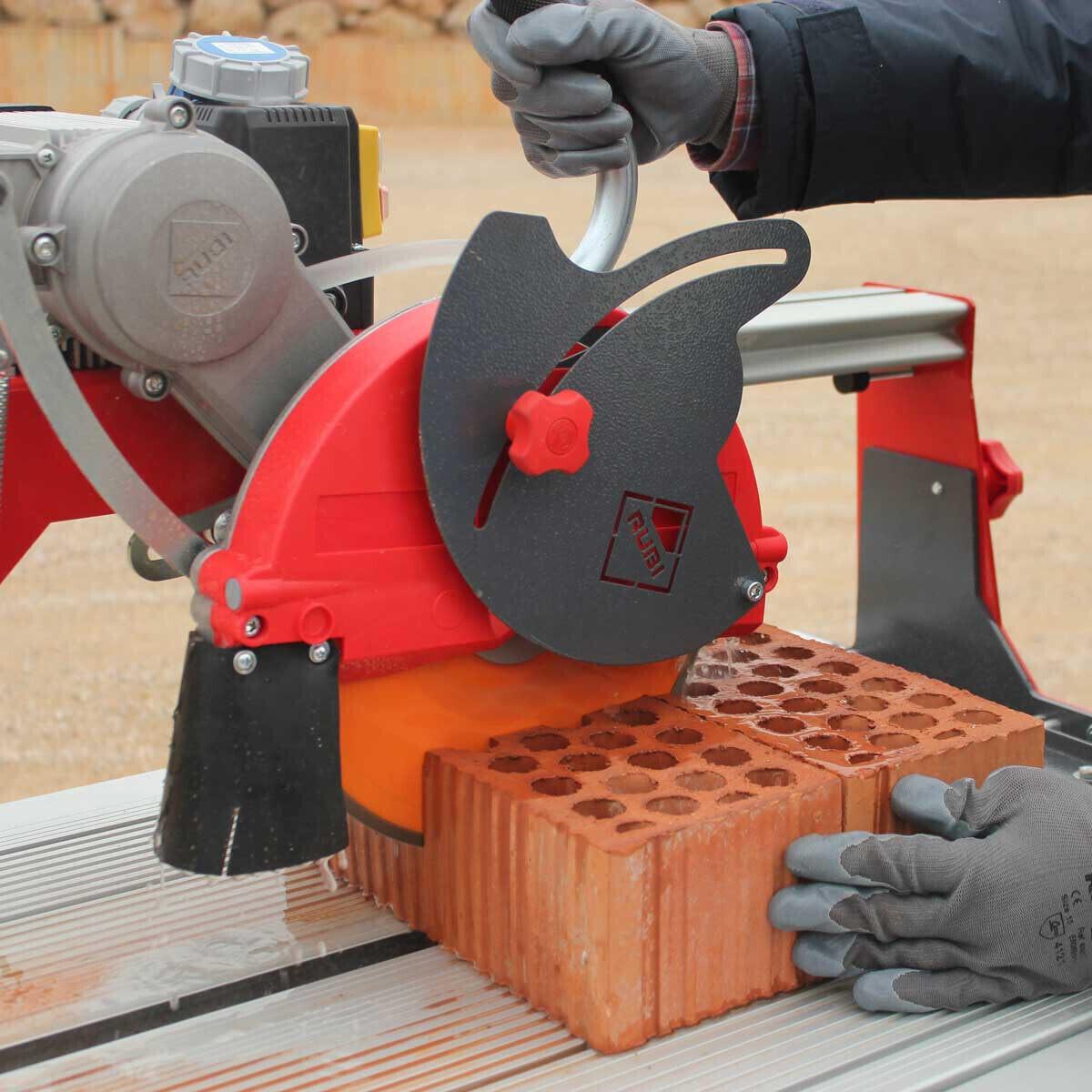 Rubi DX250-1400 Wet Tile Saw Cuts Brick