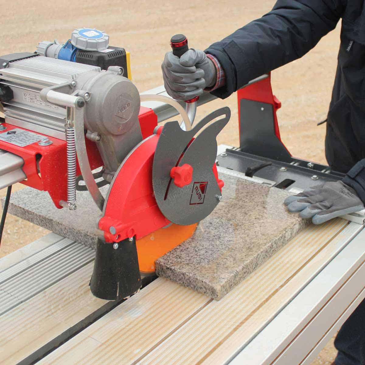 Rubi DX250-1400 Wet Tile Saw Cuts Granite