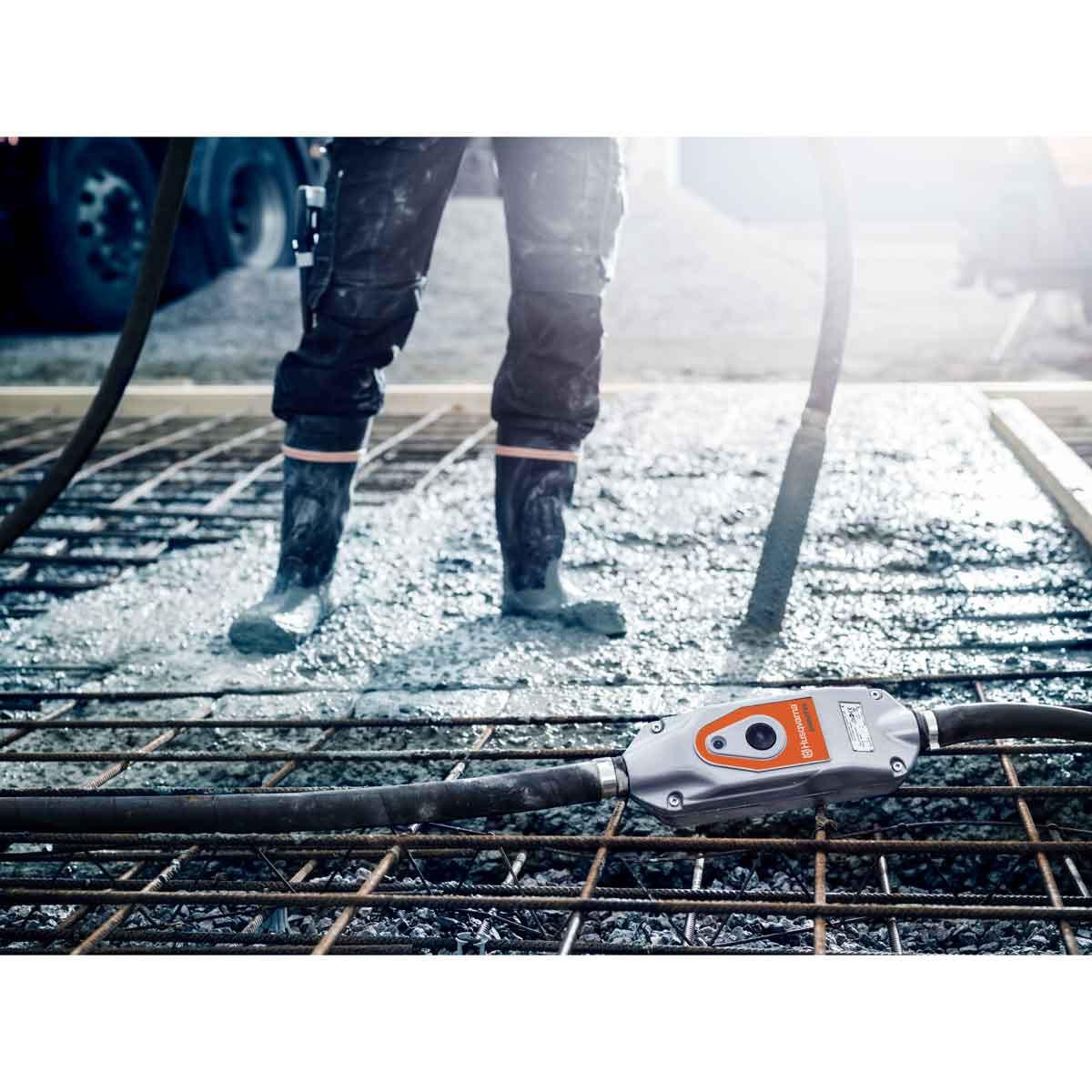 Husqvarna smart concrete vibrators in use on concrete slab
