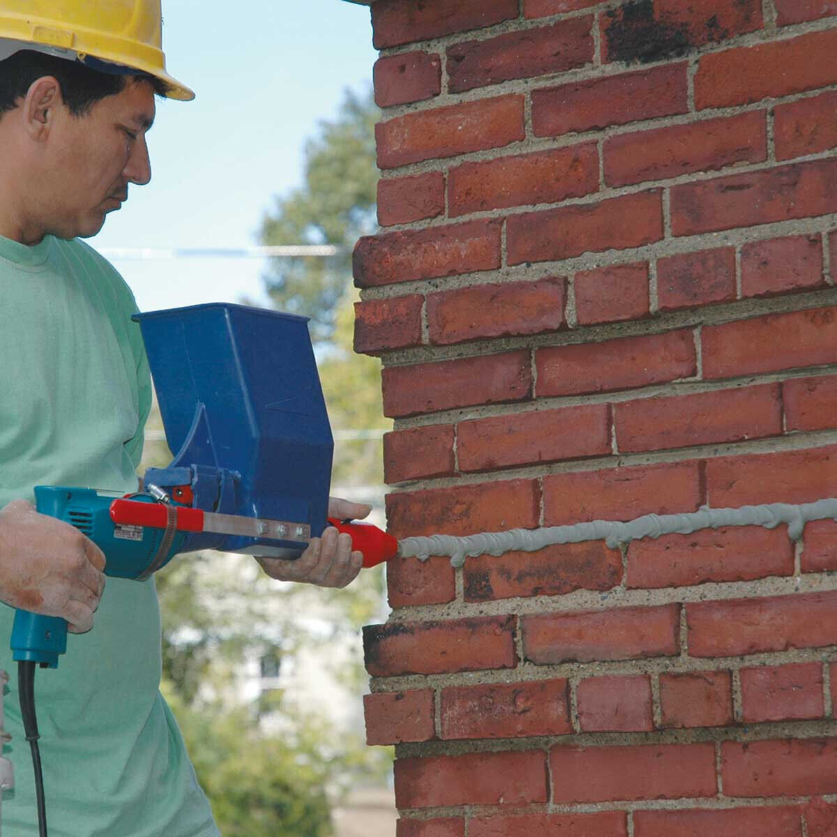 Applying Mortar with Quikpoint Gun and Drill