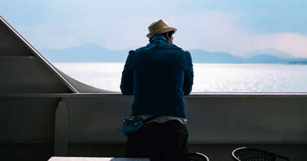 man on cruise looking at water
