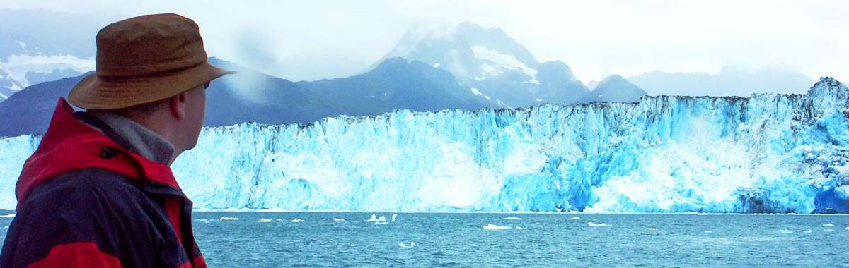 man on Alaska cruise looking at Columbia Glacier in the Prince William Sound