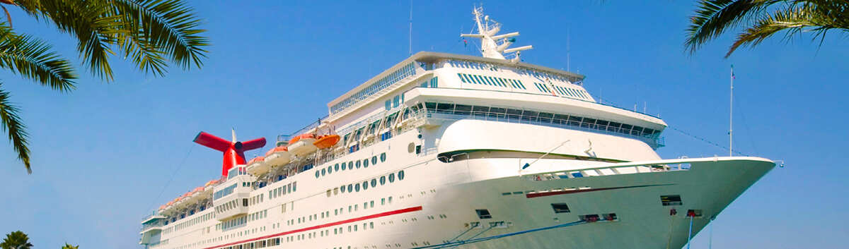 Header image of a cruise ship in a tropical port