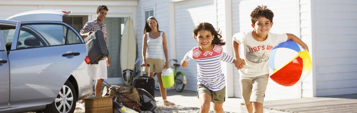 family with kids running at a vacation rental