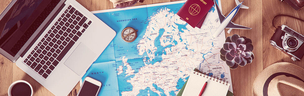 trip planning materials to decide if travel insurance is worth it