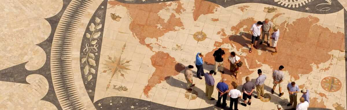 Tiled world map with people walking on it