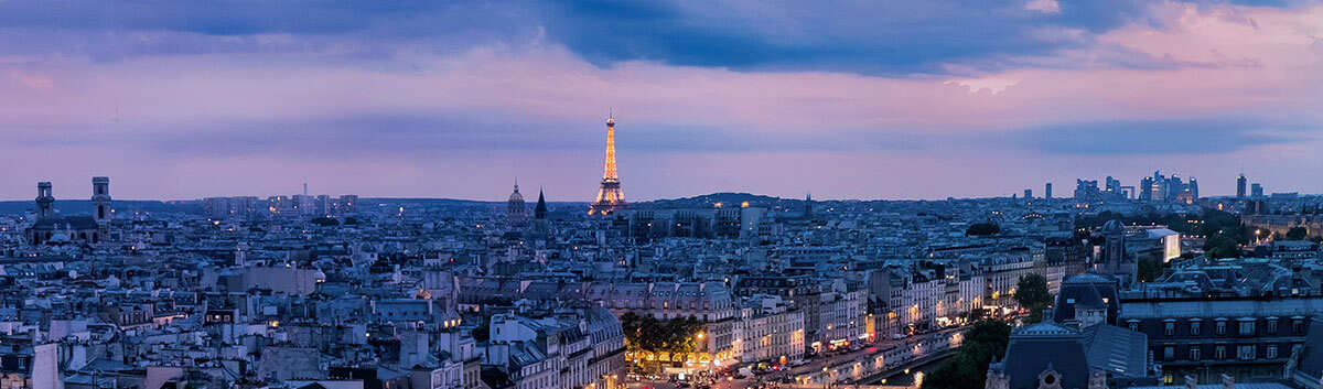 A view of the skyline at dusk of one of the most romantic places to propose- The Eiffel Tower in Paris, France.