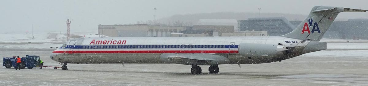 plane on runway in a snowstorm