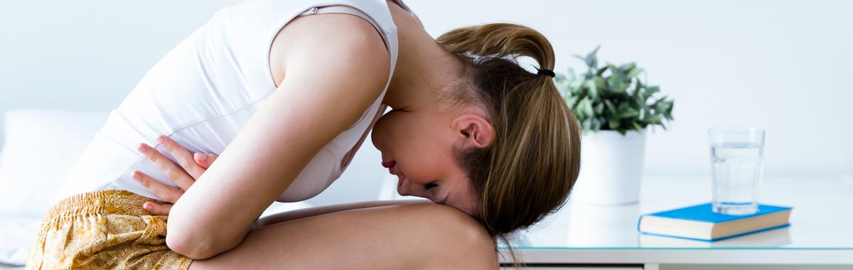woman bending over sick