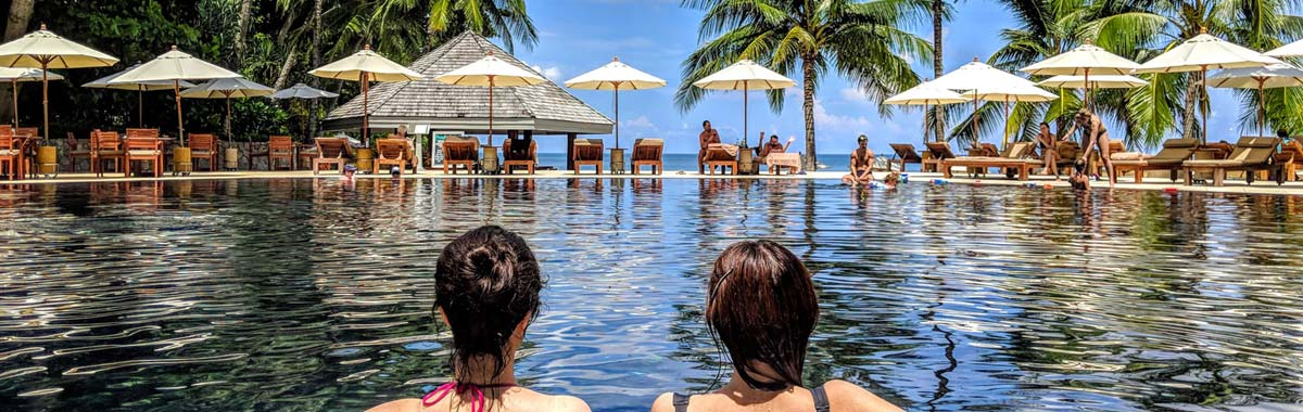 lounging in an all-inclusive resort pool