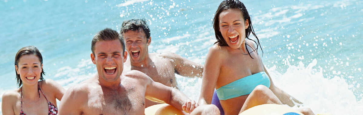 Spring break vacation fun header image with Millenials at the beach