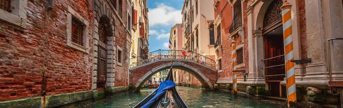 Gondola ride down the canals of Venice on a trip to Italy
