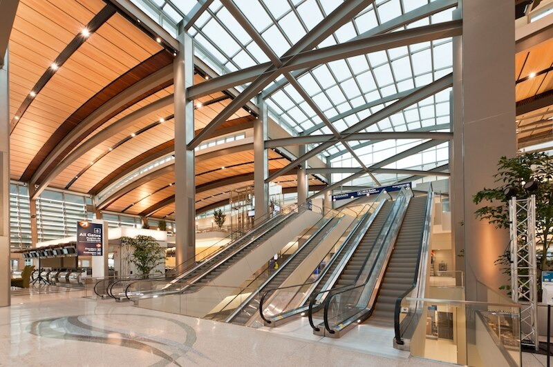 Long Span Steel Roof Framing Provides Airport With Open Spaces Evokes Natural Wonders Building Design Construction
