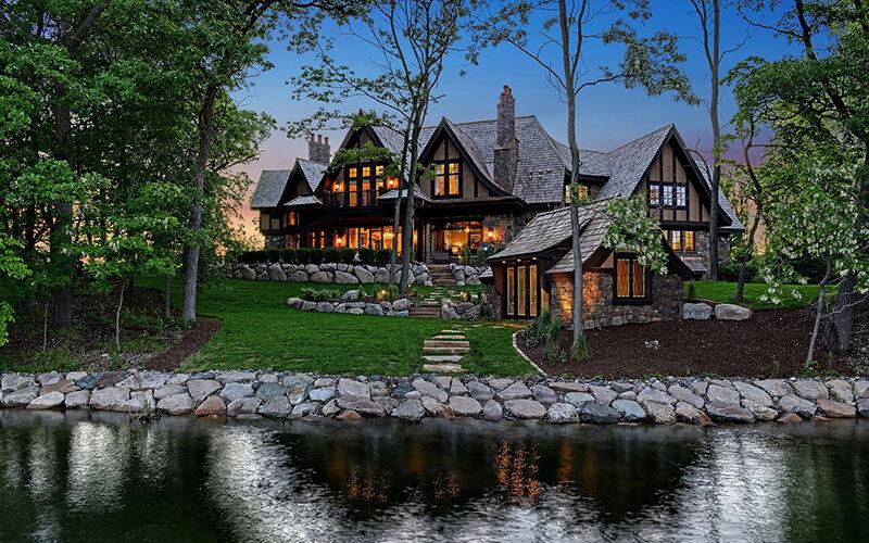 Exterior of custom Tudor home built using BuildTools construction management software.