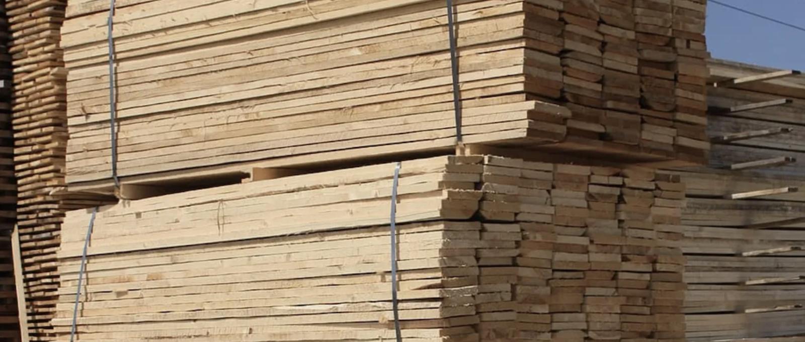 Lumber stacked in lumberyard ready for house framing