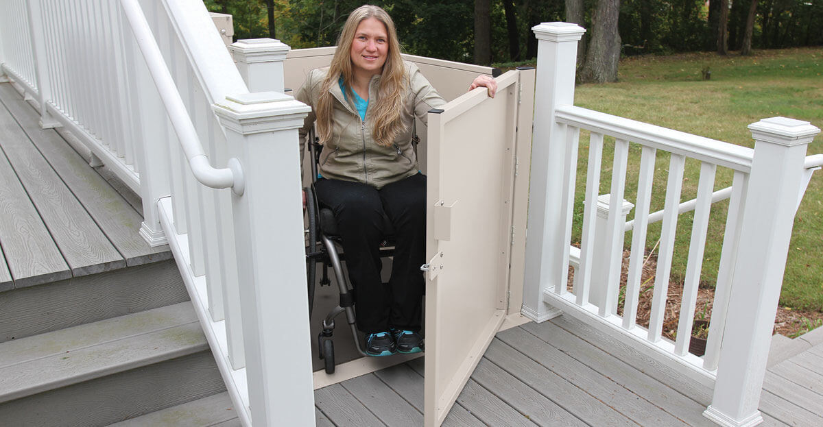 Woman in outdoor wheelchair lift