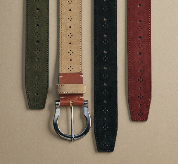 Click to shop the Stacy Adams Belts category. The image features the Richmond Suede Perf Belt in Dark Green, Sand, Black and Ox Blood colors.