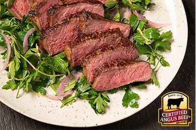 Slow Seared Strip Steak with Pickled Shallot and Parsley Salad recipe provided by the Certified Angus Beef® brand.