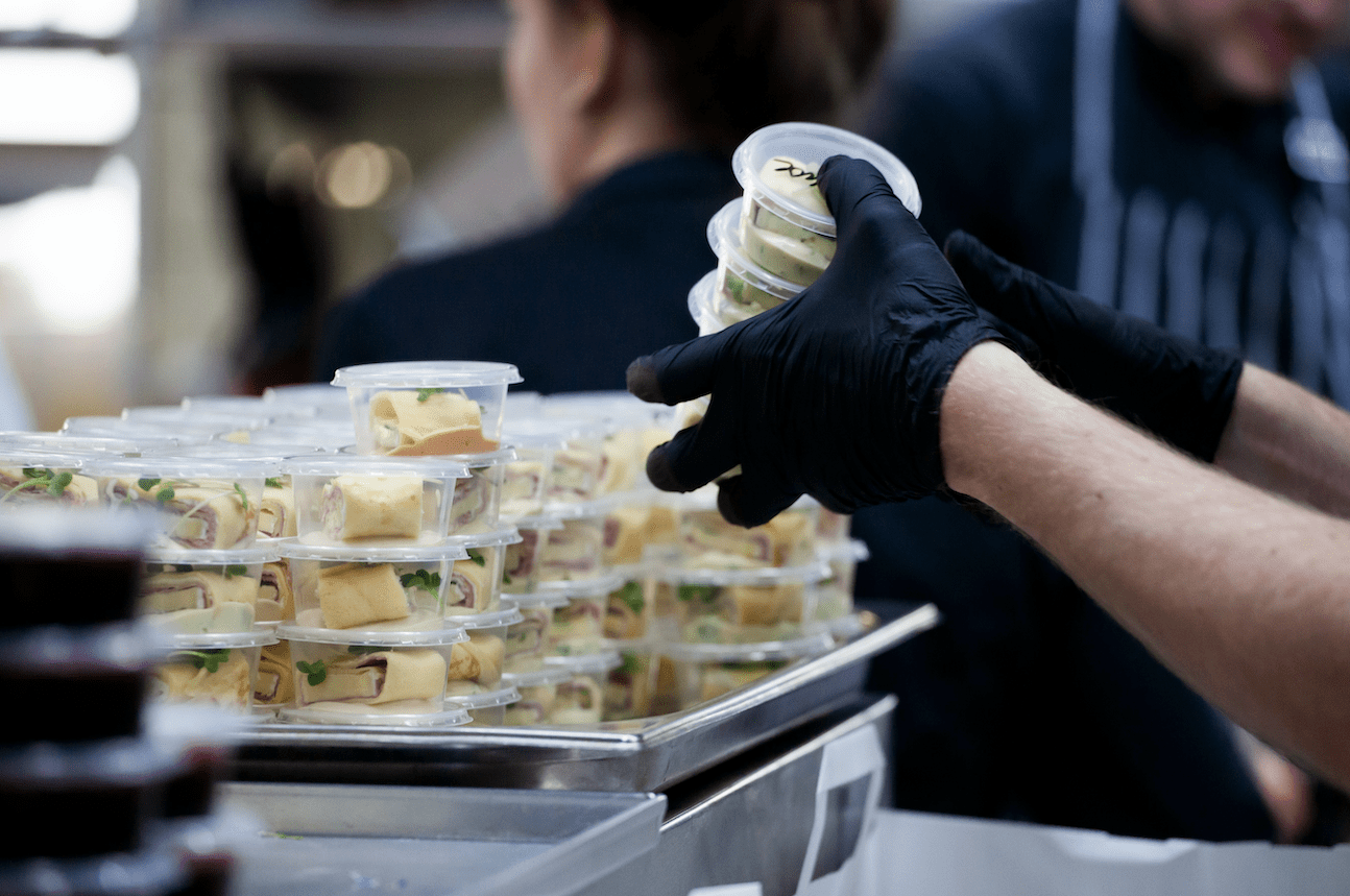 Packaging Food wearing gloves