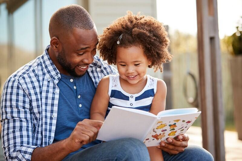 Father reads to a child