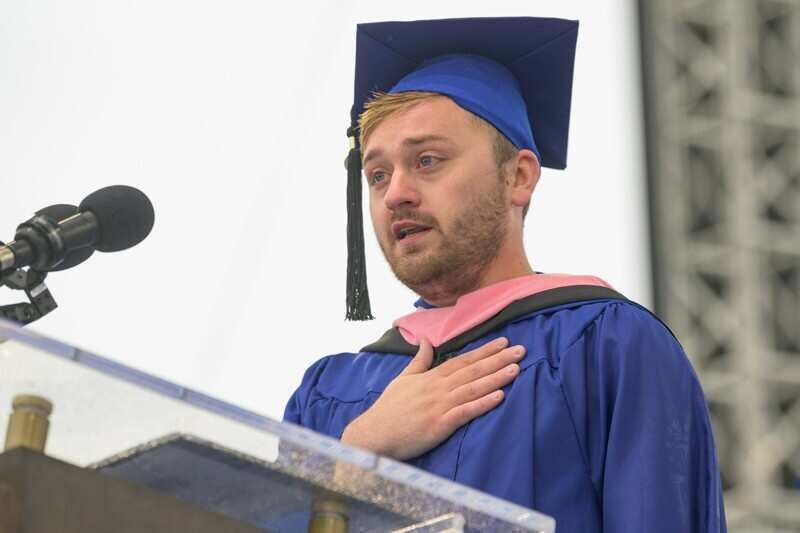 Christopher Jentzch, who received his master's degree in music on Friday, sang the national anthem before Saturday morning's Commencement Ceremony.