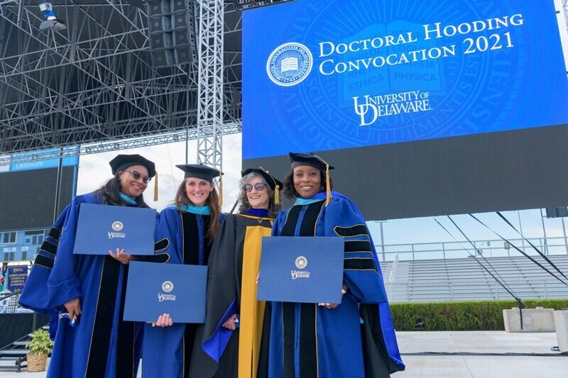 Earning a doctorate requires intelligence, hard work and help from friends, family and mentors. The University of Delaware honored its newest classes doctorates during a hooding ceremony on May 27, 2021 at Delaware Stadium.