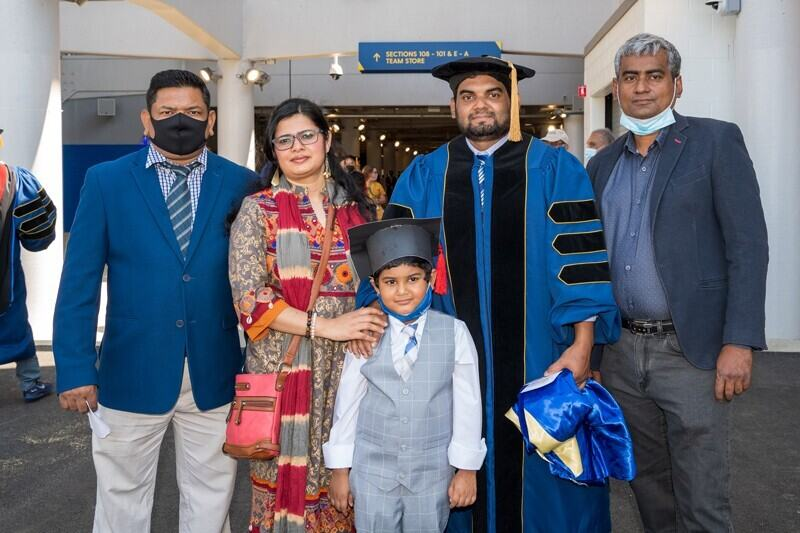 .Mohammad Afsar, who earned his doctorate in soil sciences, stands with (from left) his brother-in-law, Mohammad Hossain; his wife, Rifat Sultana; his 6-year-old son, Rishad; and his brother, Mohammad Afser, before Thursday's Hooding Ceremony.