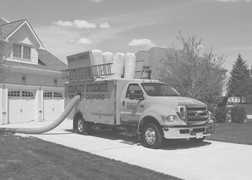 Stanley Steemer truck-mounted air duct cleaning van