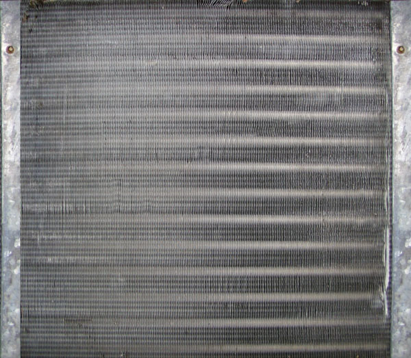 Clean evaporator coils with in-duct air purifier