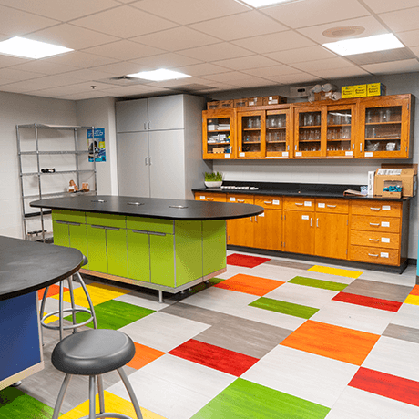 Colorful tile floor and cabinets in classroom