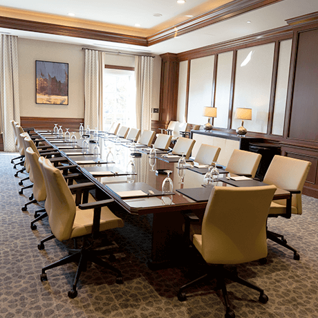 Conference room with large table and chairs in event center