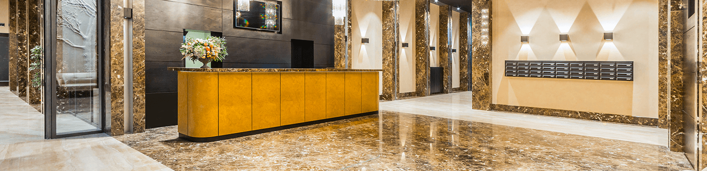 Spacious lobby of hotel with stone floors