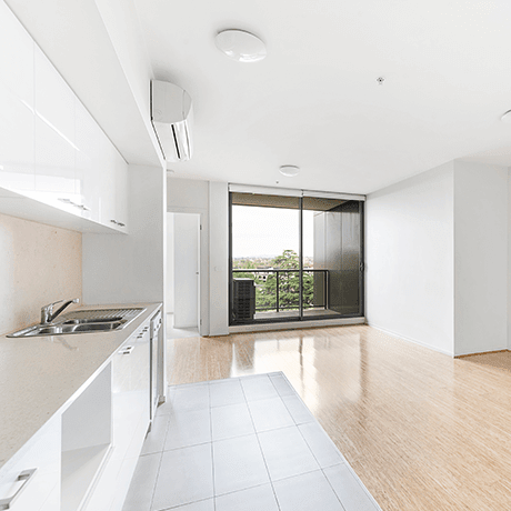 Empty apartment with tile and hardwood floors