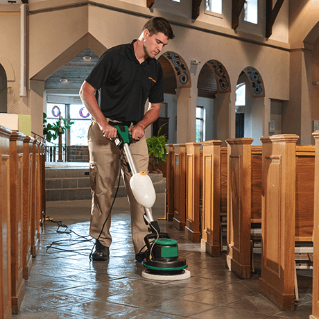 Stanley Steemer technician deep cleaning stone floors in church