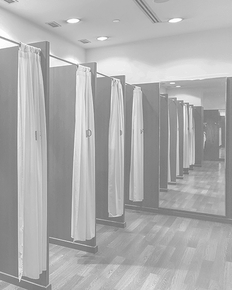Changing rooms with hardwood floors inside of retail store