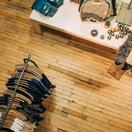 Birdseye view of clothing store with hardwood floors
