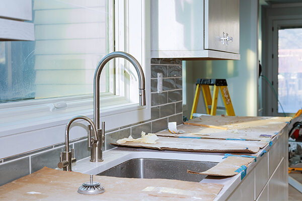 Kitchen countertop renovations with dust and debris