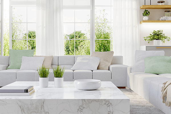 Clean room with white couches and windows
