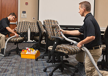 Technicians cleaning office upholstery