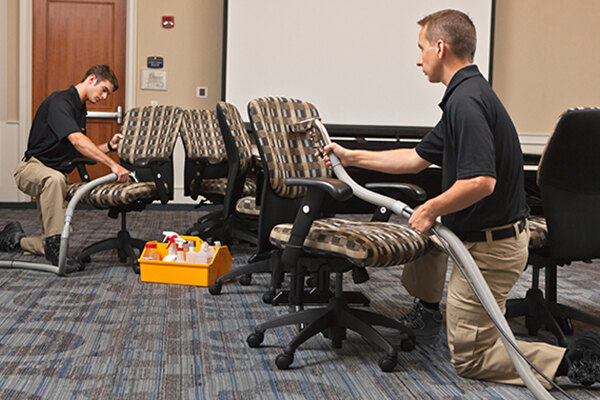 Technicians cleaning office chairs