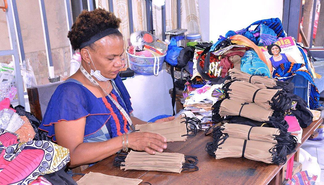 Eugenie Kabeya counts the masks she's made after pivoting her business after the pandemic