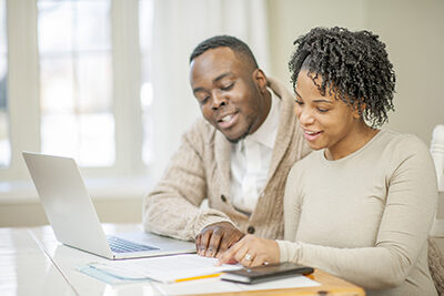 Husband and wife looking at their financial options