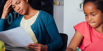 mother reviewing paperwork