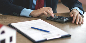 real estate agent calculating