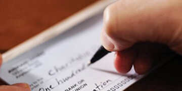 writing a check for charity