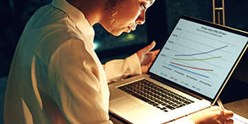 woman reviewing online graphs