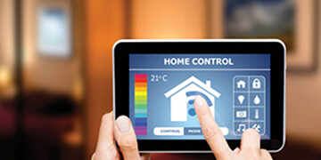 reviewing heating costs on tablet